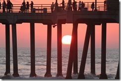 Sunset between pier pilings Ralph Palomares