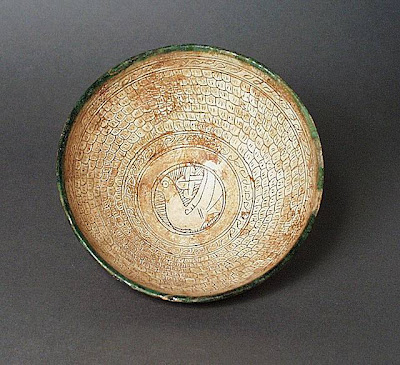 Bowl Iran Bowl, 11th century Ceramic; Vessel, Earthenware, white slip, incised, color under a transparent glaze, 3 1/4 x 7 1/4 in. (8.26 x 18.42 cm) The Nasli M. Heeramaneck Collection, gift of Joan Palevsky (M.73.5.253) Art of the Middle East: Islamic Department.