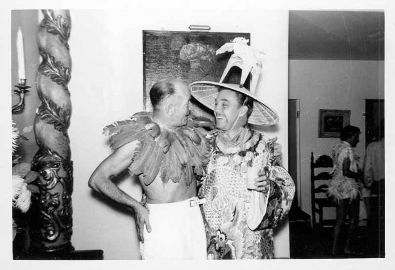 "Two men in costume at a Henry Wooton Grace ""Japanese"" party thrown at his home. Grace was a Hollywood set designer and art director from 1935-1970. Circa 1951-1958."