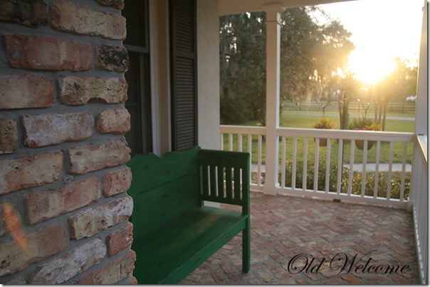 green bench old welcome front porch sun flare