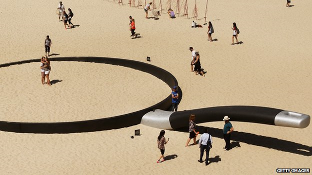 A sculpture titled 'We're fryin' out here' at a beach in Sydney, Australia, during the hottest spring on record in 2014. Photo: Getty Images