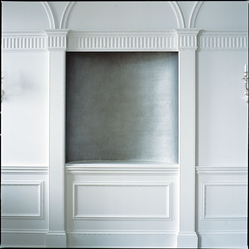 this alcove was plastered with a metallic wall covering and equipped