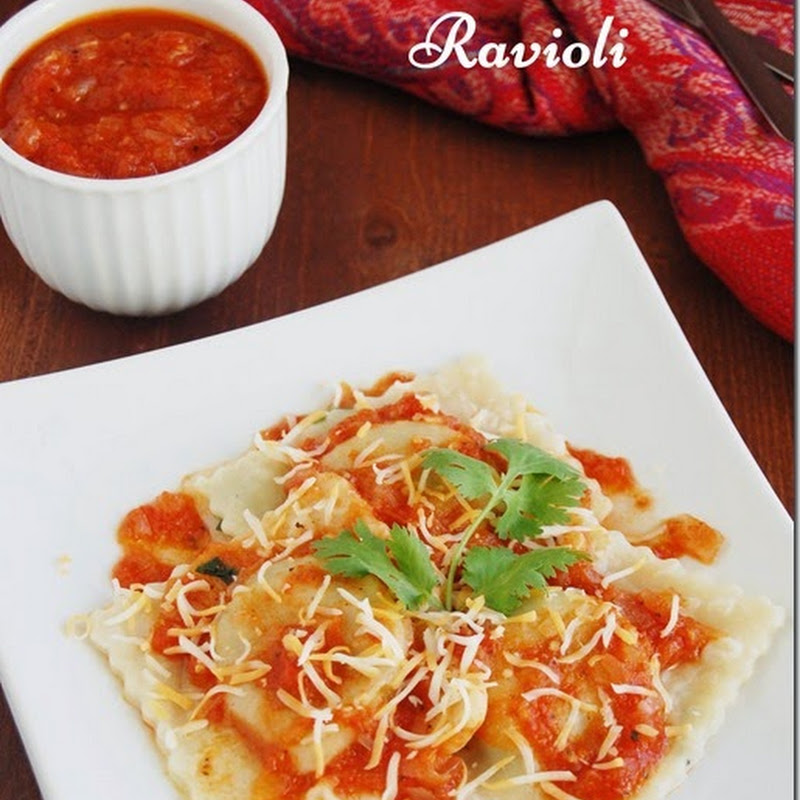Spinach and paneer ravioli with tomato sauce