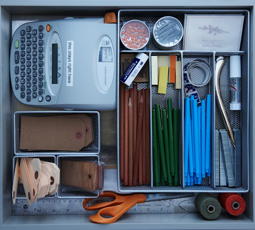 If your kitchen is the hub of your home, chances are you're constantly using it as a second office. Keep all of you labels, stationery, and other supplies in a drawer. Mesh organizers work just as well in a kitchen drawer as in a desk drawer.