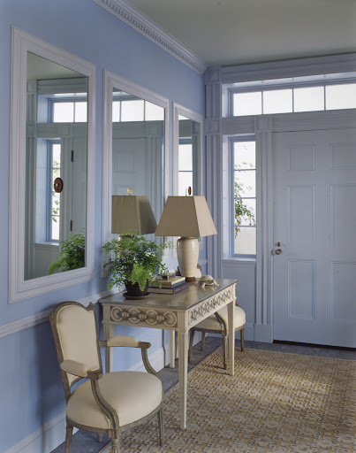 The mirrors in this entryway bring a lot of light into the space, but they also function as a place to take that last glance before darting out the door.