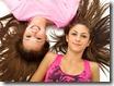 Kozzi-portrait_of_girls_lying_on_back-833x624