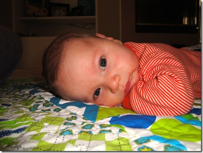 2.  Laying on quilt from aunt lyndsie