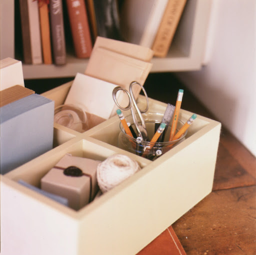 Compartmentalized boxes can hold a variety of supplies.