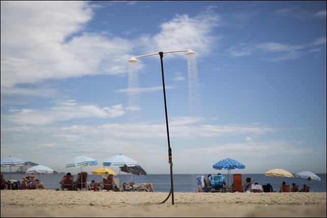 A shower runs continuously on Leblon beach in Rio de Janeiro, Brazil, Wednesday, 11 March 2015. A historic drought making taps run dry across southeastern Brazil, particularly in South America's largest city of São Paulo, has people worried they might be asked to cut down on their beloved showers. Photo: Felipe Dana / Associated Press