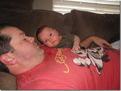 1.  Hanging out with Daddy on the couch