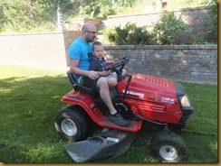 Eric and Connor on lawn mower