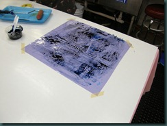 Ink on purple plastic sheet