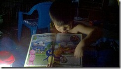 reading by lantern to Mommy (Hurricane Irene)