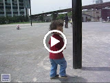 Eidan pretending to crash into posts, at the park adjacent to World City Towers in Shinagawa