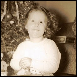 Copy of Diane sitting at little desk in front of Christmas tree_enhanced
