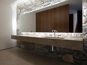 arquitectura interior baño moderno muro de piedra vista