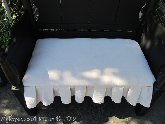Twin bed-bench upholstered