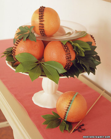 Dress up the table with a fragrant and bright pomander of oranges or grapefruits.