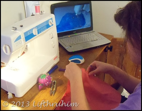 Tailorbear works on sarong using Rosie's Doll Clothes Patterns