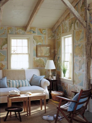 The pages of an old atlas line the walls of this room. (Martha Stewart Living, August 2002)