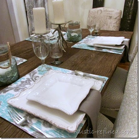 This tablescape was inspired by the temperatures outside. Using cool colors of water and a cold grey sky, I set a modern yet beachy table