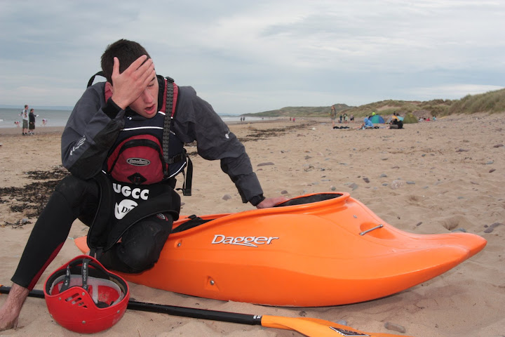 Miles recovering from a session in the 'massive' surf