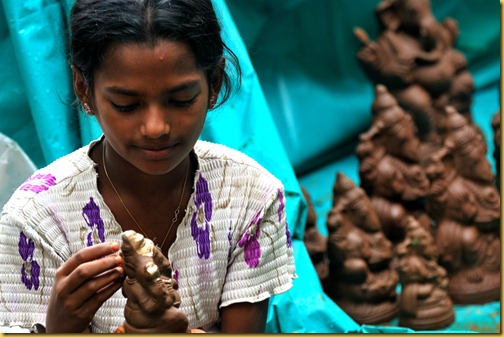 Girl selling Ganesha idols in Bangalore