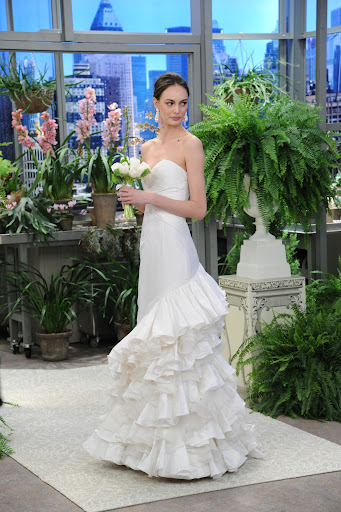 Here, Oscar's silk taffeta and organza strapless gown with tiered ruffle train.