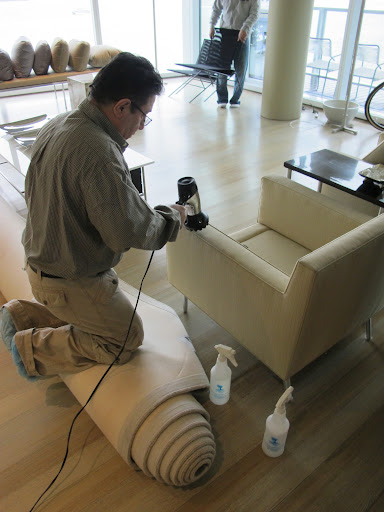 A special industrial blow dryer is used to dry the fabric after the solvent has been applied so that no damage occurs.