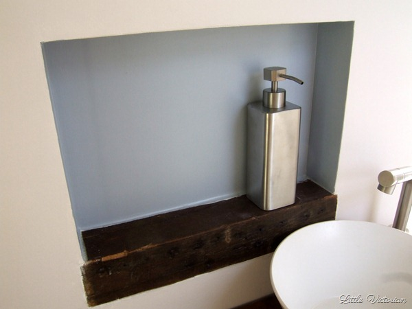 Built in wall cubby in powder room
