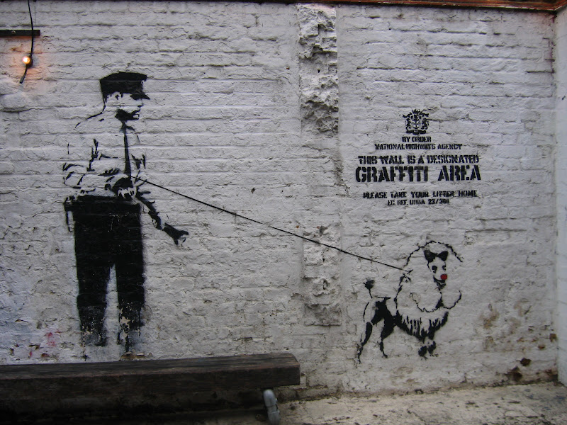 Police_and_Dog_Banksy_Graffiti_by_X_ray_Sez.jpg