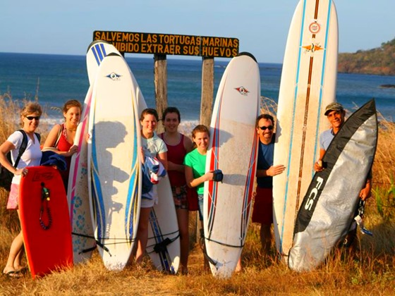 Family surf session at Camaronal Beach
