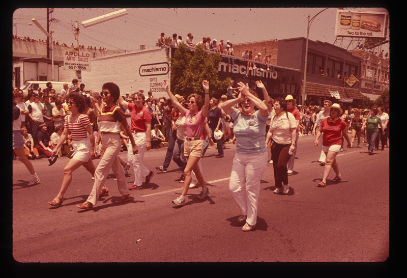 Lesbian women cheer on the crowd at the Los Angeles Christopher Street West pride parade. 1982.