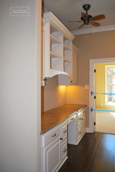 Built in desk between 2 walls with arched bookcase above