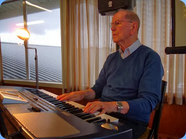 John Beales playing the arrival music on his Korg Pa500. Photo courtesy of Delyse Whorwood.