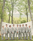 Groom Julian and his groomsmen wore light-gray suits and ties in a range of sherbet-inspired hues.