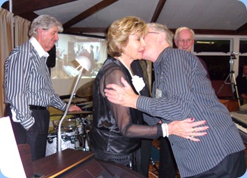 One of the joys of being the MC! Gordon Sutherland showing his appreciation to Carole Littlejohn for coming all the way from Papamoa (near Tauranga) to put on the fantastic concert. Photo courtesy of Club Secretary, Colleen Kerr.