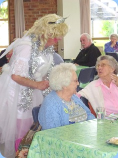 Fiona inviting a 95 years young Prescott Club member to dance
