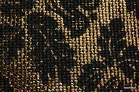 Tkanina meblowa z metalicznym efektem. Motyw roślinny - liście. Brązowa, złota.