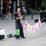 street performer in ueno - it spells: arigatou in Ueno, Tokyo, Japan