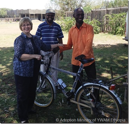 Giving bicycle to evangelist-a