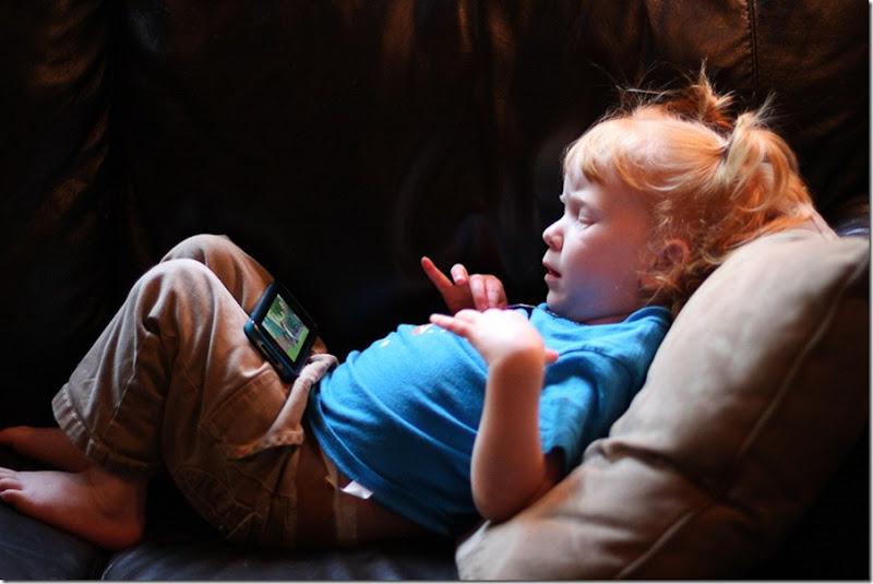 Sara watching iPhone cartoons-1-blog