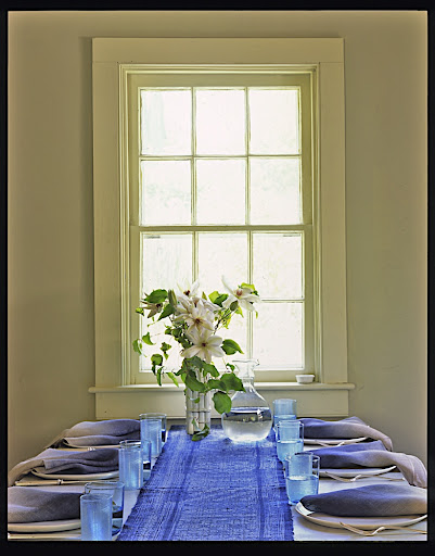 The table linens and glassware bring blue into this dining room nicely.