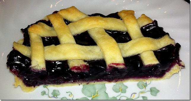 Slice of mini blueberry pie