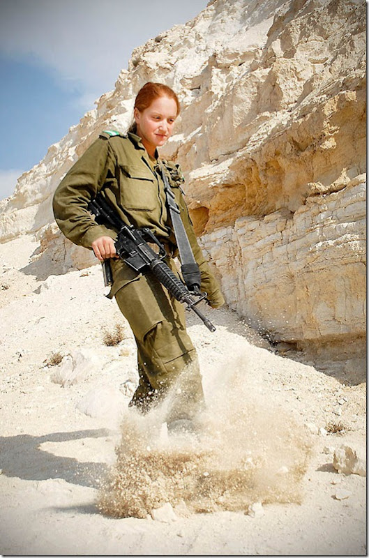 """""""Infantry Instructor at Field Training Week"""", November 16, 2010. In celebration of the upcoming International Women's Day, we've decided to share with you photos of women serving across the range of different units in the IDF. On the ground, in the sea, or in the air; the IDF's women take equal part in protecting Israel at all times. Pictured: A cadet in the Infantry Instructor's Course during the Field Training Week, in which soldiers practice individual and group drills, navigation practice, sleeping in the field and camouflage training."""