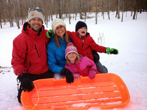 Deet and Heidi family having fun on the sledding hill.