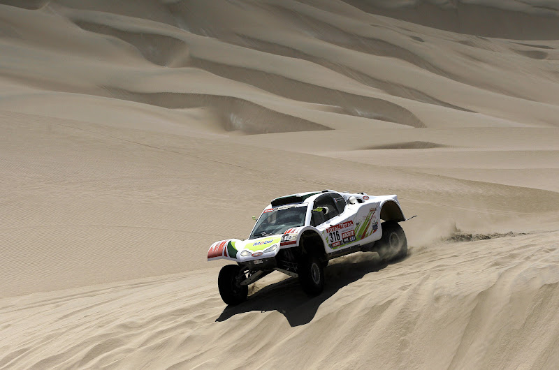 SMG's driver Ronan Chabot and co-driver Gilles Pillot, both from France, compete in the 12th stage of the 2012 Argentina-Chile-Peru Dakar Rally between Arequipa and Nazca in Peru, Friday Jan. 13, 2012. (AP Photo/Martin Mejia)
