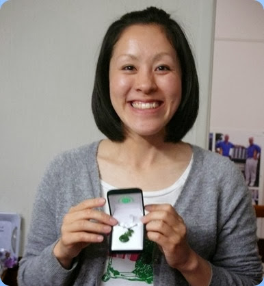 Kuniko showing the greenstone Koru necklace that the Club presented as a thank you to Kuniko for all her wonderful music at the Club and our Community events over the  last 7 months. Everybody signed a card as well to wish her Bon Voyage. Photo courtesy of Dennis Lyons.