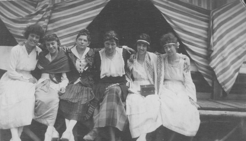 Dorothy Putnam sits (third from left) with the Camp Estell Camp Fire Girls. 1914.