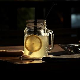 lemon in glass by Kurniawan H - Food & Drink Fruits & Vegetables ( water, glass, lemon )